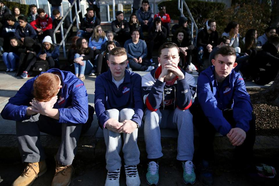 Somerville students sat along Highland Avenue during the protest.